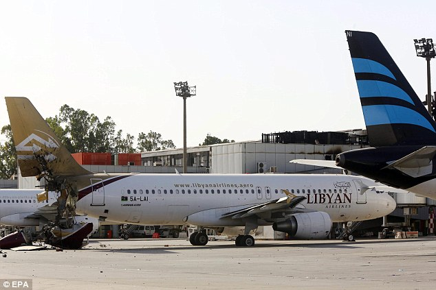 Aftermath: Tripoli International Airport was overtaken by the group Libyan Dawn last month and now 11 aircraft for Libyan Airlines and Afriqiyah Airways are now missing. Above, a Libyan Airlines plane damaged in the battle, pictured on August 26