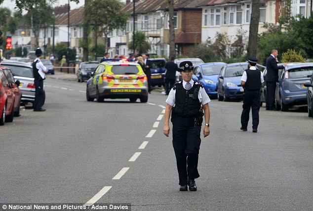 Officers cordoned off the road as investigators combed the scene for clues