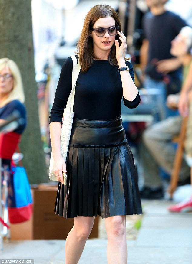 Anne Hathaway Cuts A Stylish Figure In Red Sixties Style