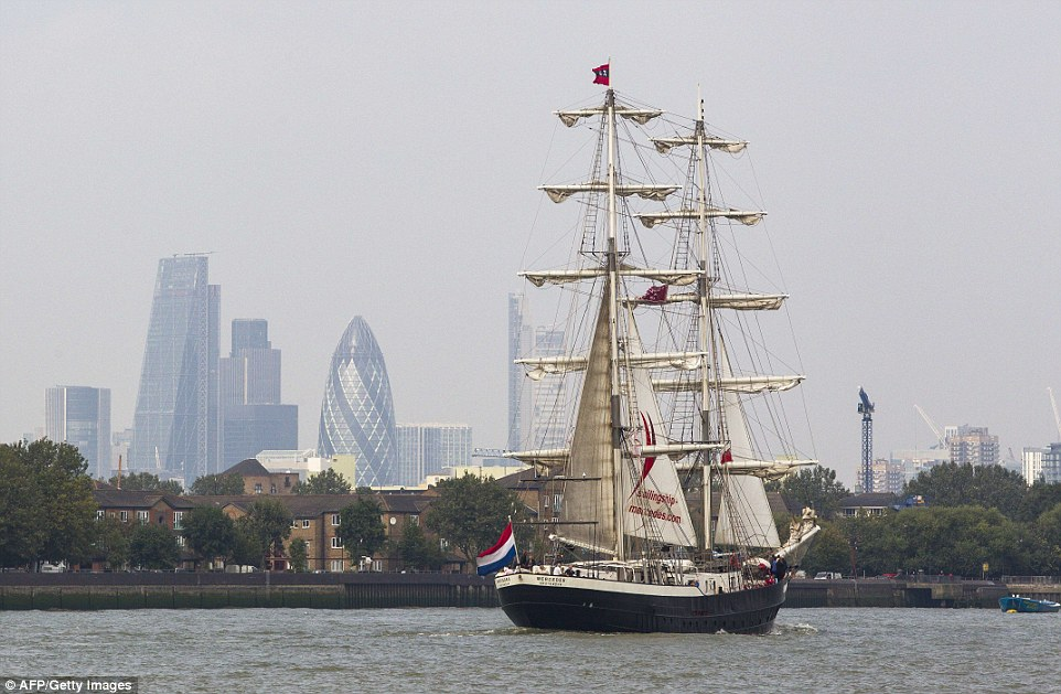 At the start of the festival, the vessels sailed past famous landmarks, such as Canary Wharf and the City of London, pictured above