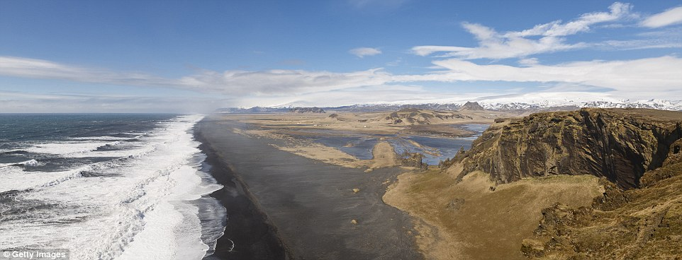 From sea to sky: A beach near the small Icelandic peninsula of Dyrholaey, a former volcanic island, features incredible black basalt sand that developed after eruptions