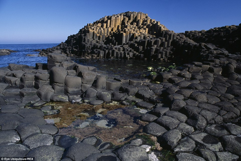Rugged beauty: Giant¿s Causeway is a series of nearly 40,000 basalt columns of cooled molten lava in County Antrim on the northeast coast of Northern Ireland
