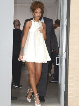 Making it her own: Rihanna added a double strand of pearls and strappy white heels