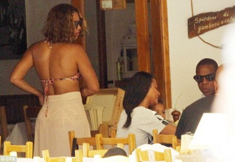Making the cut: Beyonce took her hat off at lunch with pals, revealing her honey-blonde hair and her shorter do