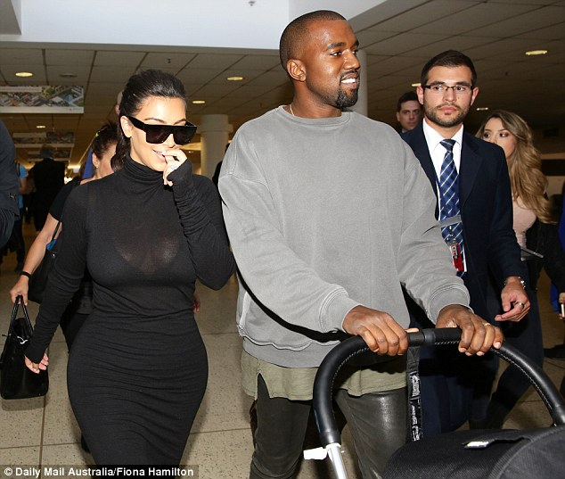 Kim Kardashian Shows Off Famous Curves In Sheer Turtleneck