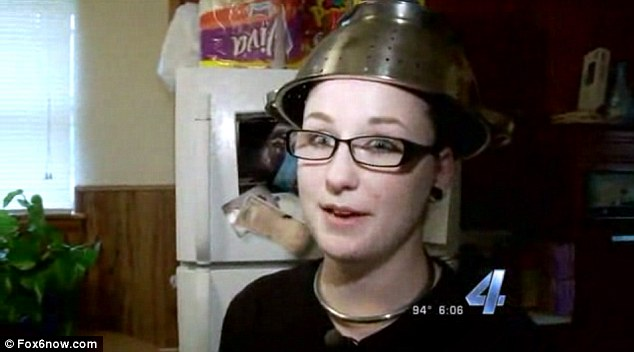 Shawna Hammond wore the unusual headgear because it is deemed a suitable accessory for her 'Pastafarian' religion, the Church of the Flying Spaghetti Monster