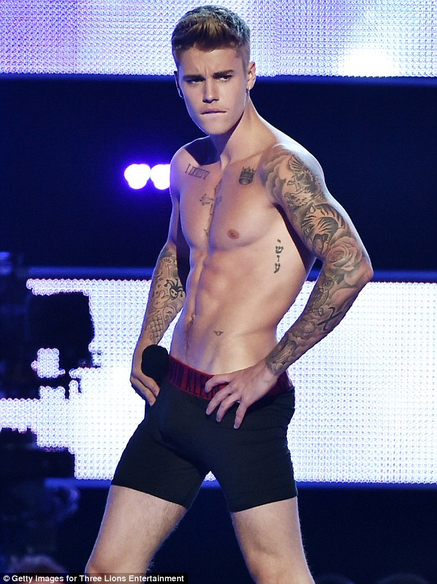 Flexing it: Justin flashed his muscular abs on TV