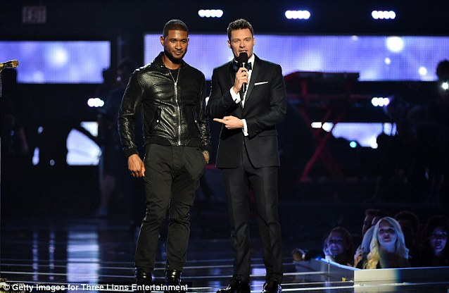 The host with the most: Ryan Seacrest introduced Usher while wearing a tuxedo