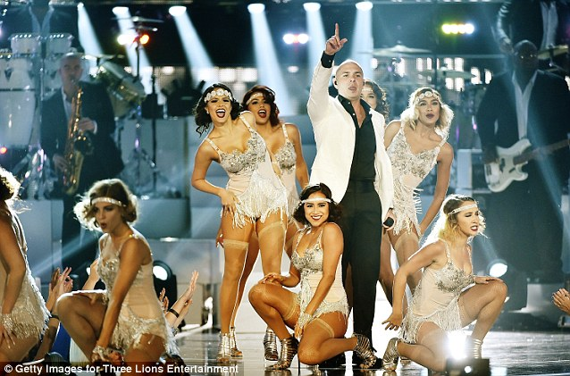 Leading the pack: Pittbull took to the stage and performed with dancers wearing flapper inspired getups