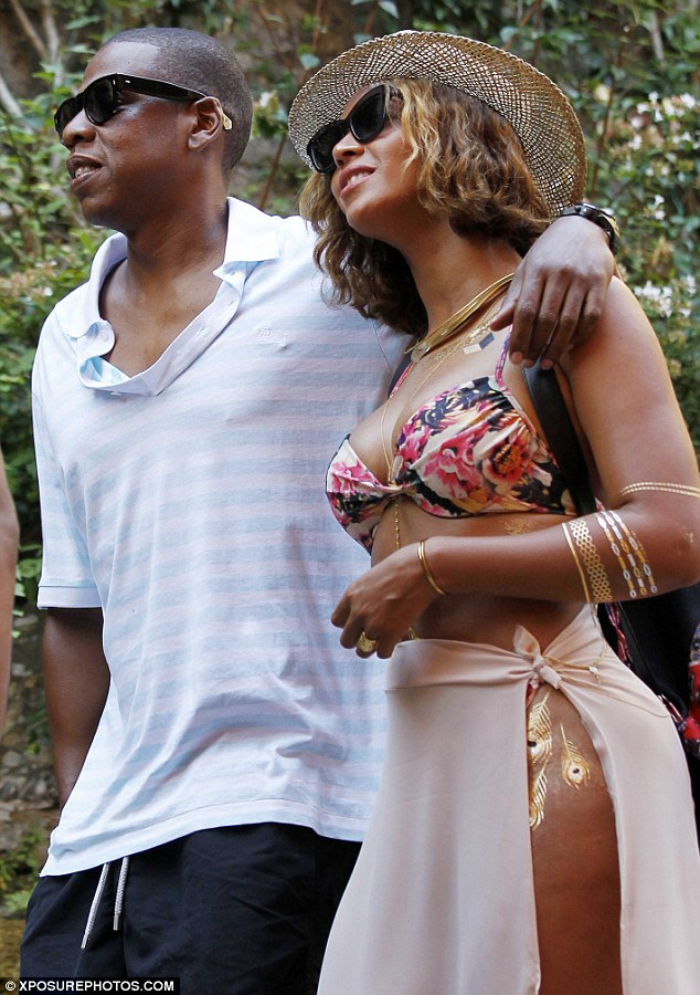 Unlikely spot: On Saturday, she also showed off gold peacock fathers in her hips as she stood with Jay Z in Portofino, Italy