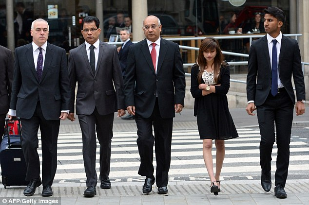 Family: The family of Ms Saldanha, including her husband Benedict Barboza (second left) and two teenage children Lisha and Junal (together, right) have also arrived at the Royal Courts of Justice for the first day of the inquest, with MP Keith Vaz (centre)