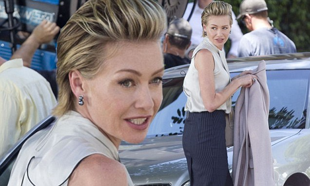Portia De Rossi Slicks Her Hair Back And Dons A Pencil