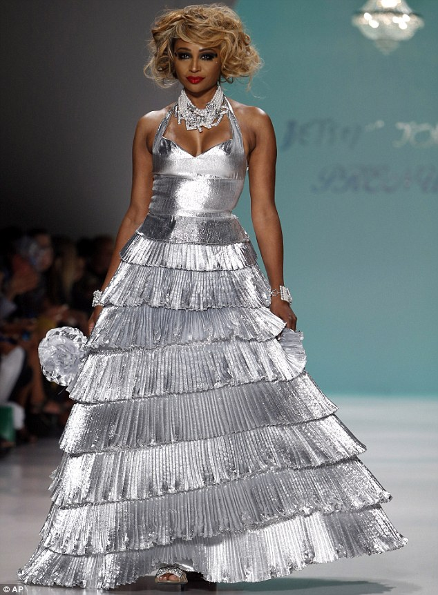 Silver siren: Cynthia Bailey, from The Real Housewives Of Atlanta looked striking in a tiered metallic halterneck dress and tousled hairstyle