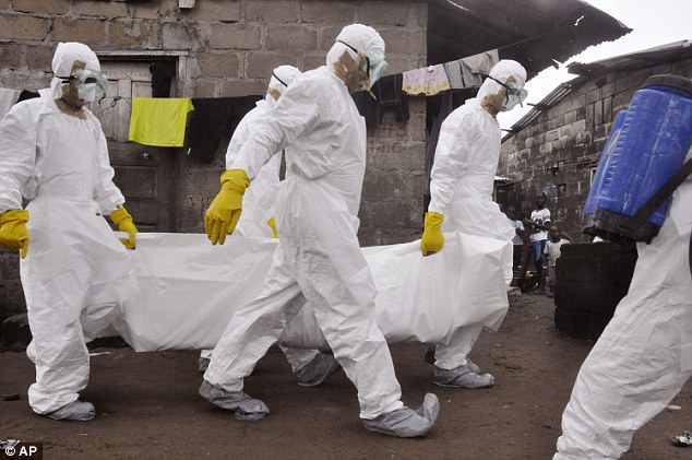 As the Ebola outbreak rampages through West Africa, one expert has warned the virus could mutate to become airborne. Pictured are health workers carrying the body of a woman they suspect died from the virus in Clara Town, Monrovia in Liberia