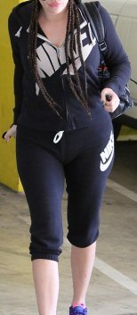 A Nike girl: The TV star wore a Nike zip-up hoodie with Nike capri pants and purple and pink Nike trainers for her session