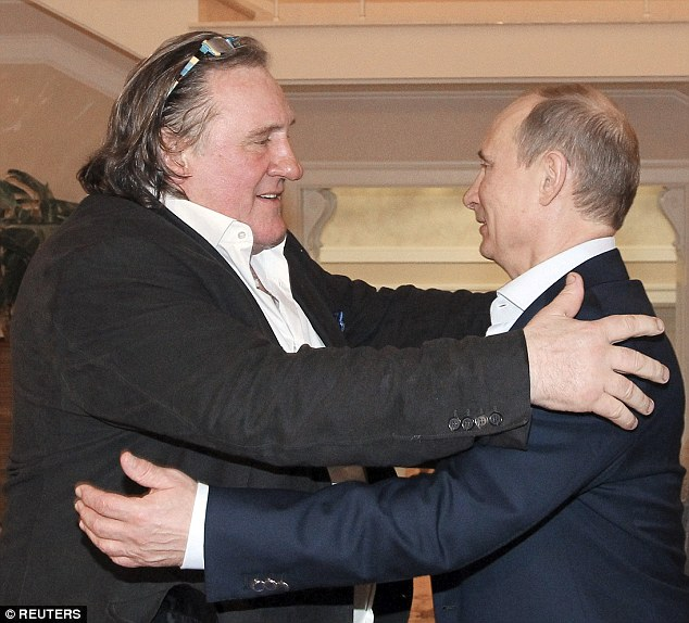 Comrades: Depardieu, seen her with Vladimir Putin, took Russian citizenship in January 2013 as a protest against France's 75 per cent tax on the rich