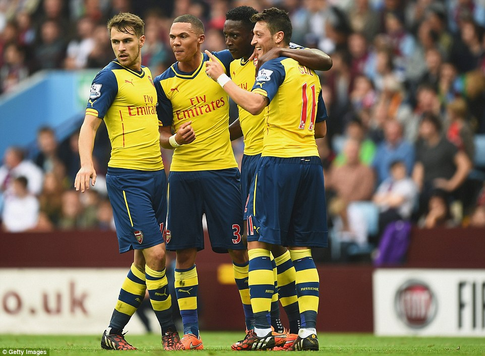 Ozil (right) is congratulated by team-mates Welbeck (second right), Kieran Gibbs (second left) and Aaron Ramsey