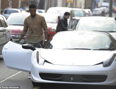 Eye-catching: Liverpool striker Daniel Sturridge pulls up outside a takeaway in his gleaming white Ferrari on Thursday