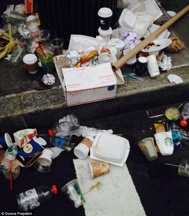 Disrespectful: Trash can be seen littering the route following the climate change march on Sunday