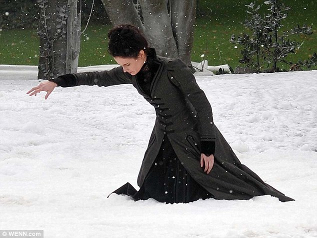 And action: Eva Green was the centre of the shot as she acted her scene knelt on the fake snow