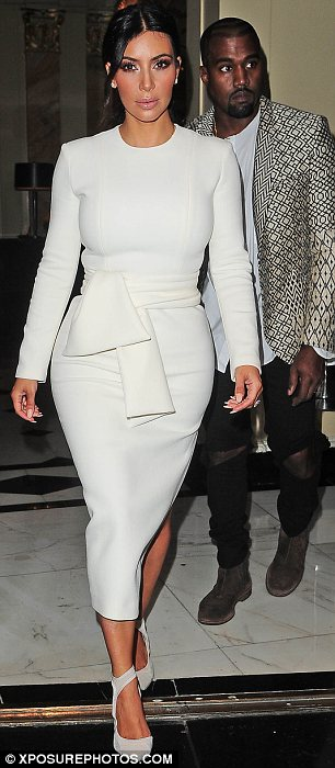 Style star: Kim's figure hugging dress featured a side split which showed off her toned legs