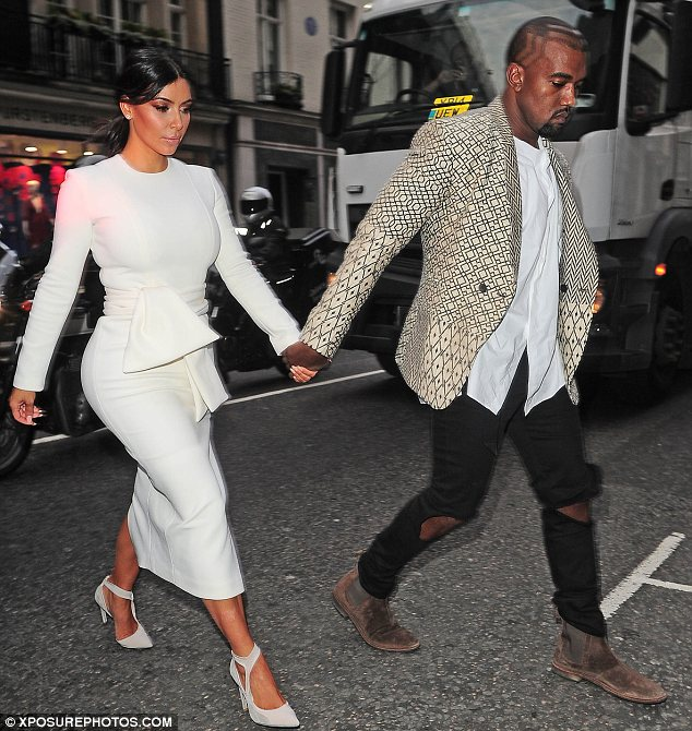 Date night for Mr and Mrs West: Kim Kardashian and Kanye West held hands as they left their hotel in London on Tuesday  with Kanye showing off his new hairstyle