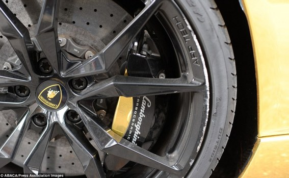 Even the brake callipers on the distinctive supercar seen in Paris over the past few days are gold coated