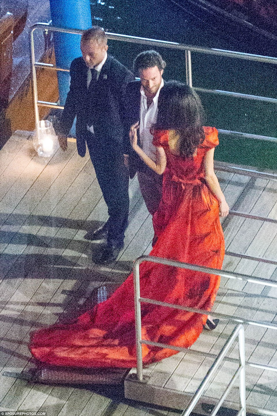 Follow me: The stunning lawyer was seen chatting away to her guests as they made their way off the boat
