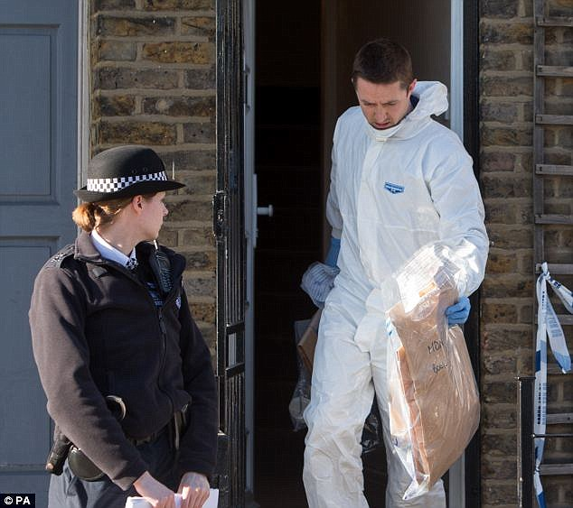 The boy had been keeping the weapon - which had been used in a gangland shooting a month earlier - for a unknown criminal in Hackney, east London, the court heard. Forensic teams are pictured removing evidence