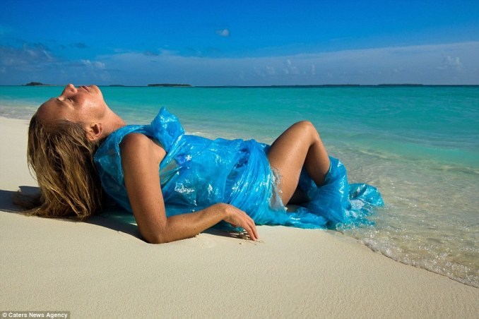 Making a statement: Alison wraps herself in a plastic bag that she found floating in the water around the idyllic islands in the Maldives
