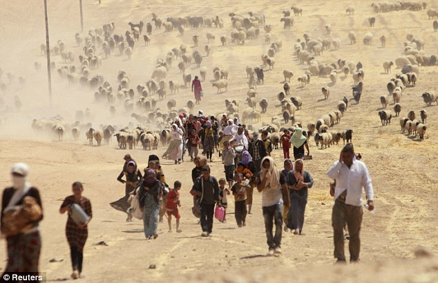 Displaced people from the minority Yazidi sect, fleeing violence from forces loyal to the Islamic State in Sinjar town, walk towards the Syrian border. Two Yazidi teenagers who escaped the clutches of Isis have revealed the full horror of their capture and captivity