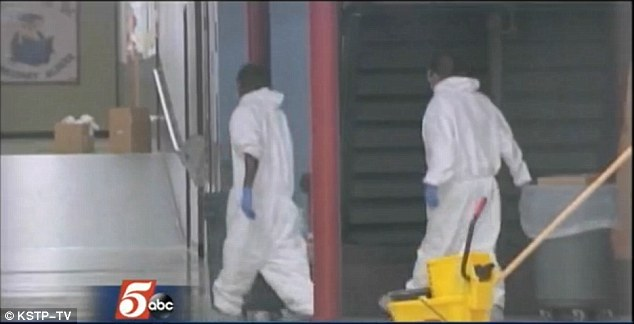 A cleaning crew in hazmat suits enter Lowe Elementary School in Dallas, Texas on Wednesday as the schools attended by the children who came in contact with Ebola patient Thomas Eric Duncan underwent deep cleans