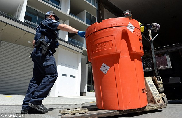 Queensland Police removed a toxic-labelled container on Monday, following the discovery of Ms Prasetyo's body parts found boiling in chemicals in a Brisbane apartment on Saturday night
