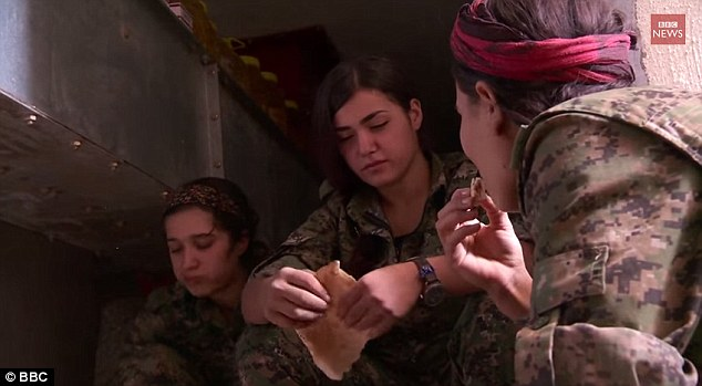 Brave: In an interview with the BBC last month to discuss the role female Kurdish fighters play in combating terrorist group, Miss Ozalp (pictured centre) said: 'We're not scared of anything. We'll fight to the last. We'd rather blow ourselves up than be captured by ISIS'