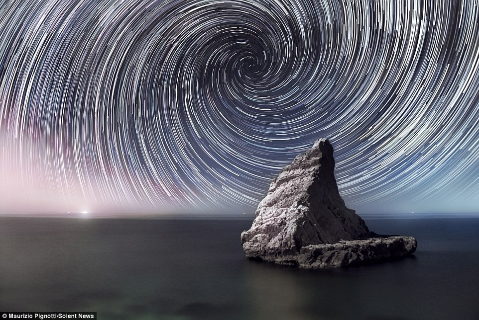 Photographer Maurizio Pignotti has revealed amazing images of the night sky above beautiful vistas on Earth, created by Earth's rotation