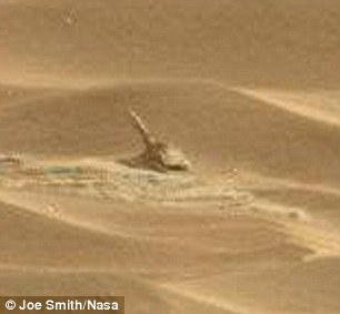 Nasa has been beaming photos from Mars since its Curiosity rover landed there in August 2012, and this latest discovery (pictured) was spotted by amateur astronomer Joe Smith, 45, from Bristol. Mr Smith said: 'I think it looks like a gun - as in an artillery piece - but it's way too small for that really'