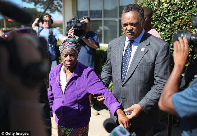 Condemnation: Reverend Jesse Jackson, seen here with Duncan's mother, raised the specter of a lawsuit and said Duncan's care was partially to blame for his death