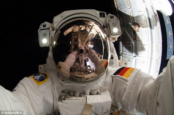 Astronaut captures selfie taken during spacewalk on the