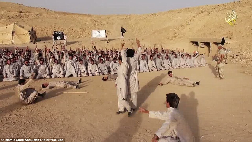 Watching on: The new video from the Islamic State (ISIS) shows more than 100 recruits at a training camp