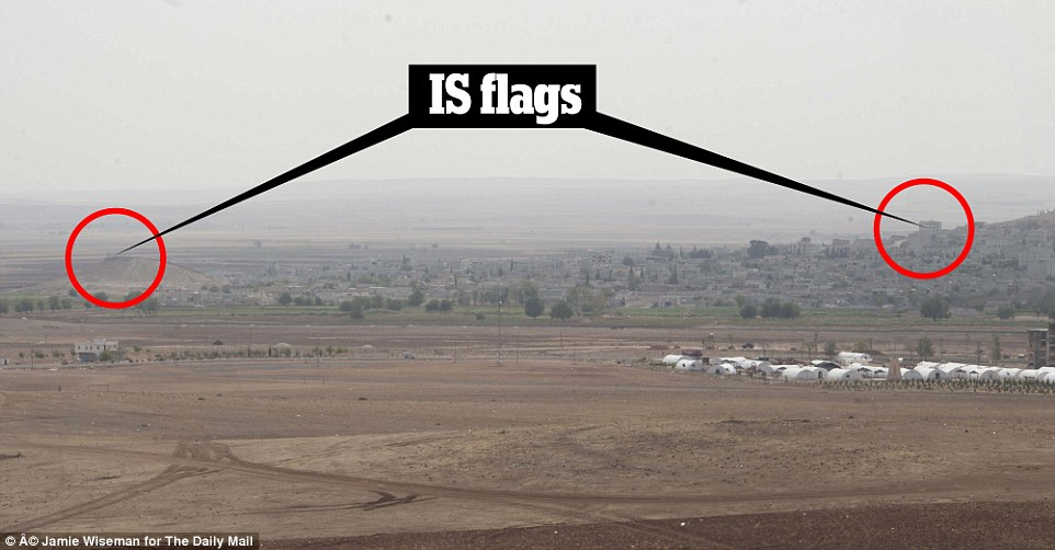 Trapped: This image shows the Islamic State flag in both the east and west of Kobane, proving ISIS militants have encircled the city