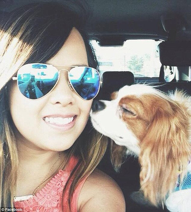 Tragic: Nina Pham, 26, is fighting for her life after contracting Ebola from Thomas Eric Duncan. Here she is pictured with her beloved King Charles Spaniel clled Bentley who is not expected to be destroyed