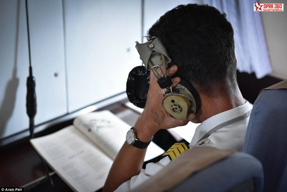 The communications officer on the flight sat outside the cockpit in the passenger area and listened in with an ancient looking pair of headphones