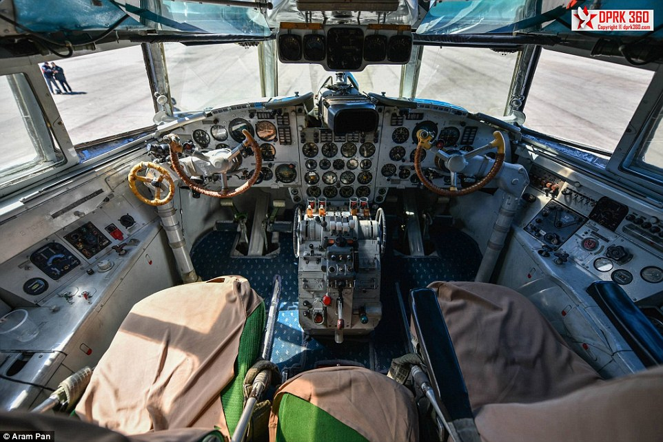The old green seats in the Ilyushin Il-18 cockpit are covered with beige material. The empty weight of the plane is 35,000 kg