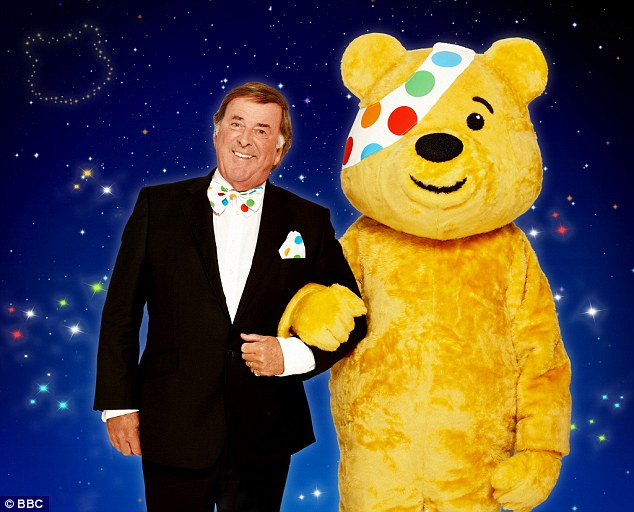 Charity accounts reveal £87.7million invested in portfolios which the BBC will be handed out once they assess the impacts of other projects (pictured, charity mascot Pudsey and show host Terry Wogan)