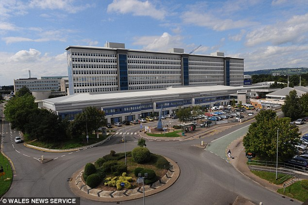 The 46-year-old was sent on 'gardening leave' in April 2012 and a formal investigation was launched by health bosses at the University Hospital of Wales in Cardiff, pictured. While they declined to comment on the allegations against Mr O'Keefe they said the case has nothing to do with the standard of his work