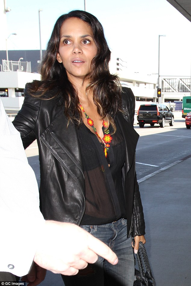 Halle Berry Zooms Out Of LAX In Biker Boots And Leather