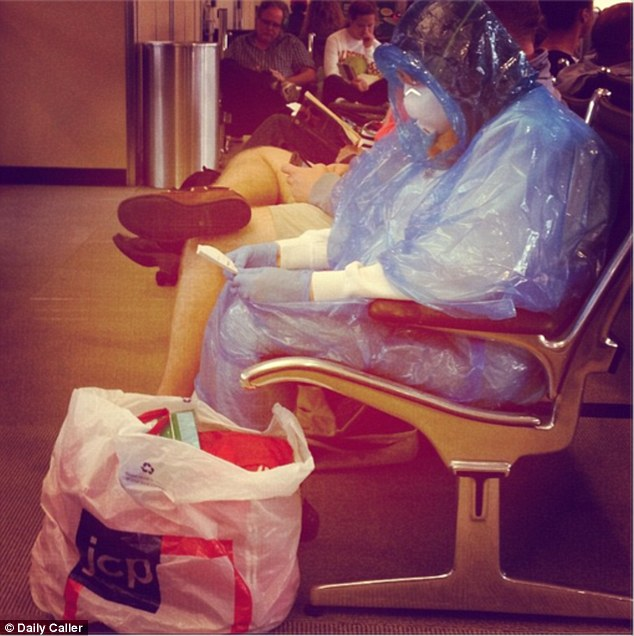 The above woman was seen waiting for a plane at Washington Dulles Airport on Wednesday, the same day another nurse was diagnosed with the deadly virus