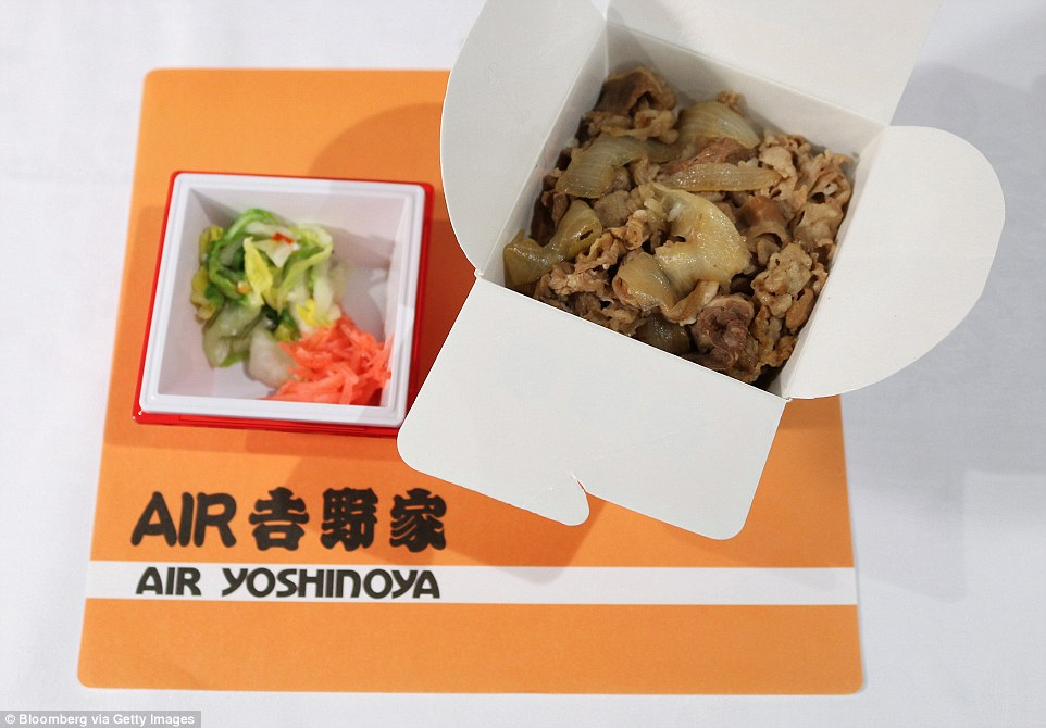 An inflight meal of rice topped with beef for Japan Airlines and served with a side of shichimi (seven-flavoured spice) pickled vegetables. The airlines collaborated on these particular meals with Yoshinoya Holdings, a Japanese beef-bowl restaurant chain