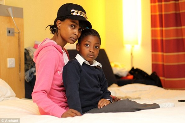 Lucille Wanjiru, 32, pictured with her daughter, spent four years living in hotels paid for by the taxpayer while she waited for the Home Office to find the paperwork which proved she had the right to stay in the UK