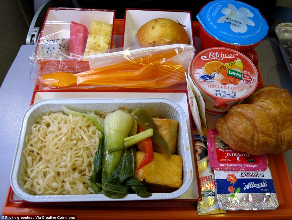 DrukAir 's economy meal  doesn't fare too badly. Bhutan's national carrier serves spicy tofu and vegetable noodles, with dragonfruitm melon and pineapple on the side, a yoghurt pot, a croissant and a muffin